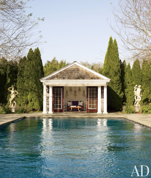 Two 19th-century Italian stone statues watch over the pool at Alex Papachristidis's home in Bridgehampton, New York. Photo by William Waldron.