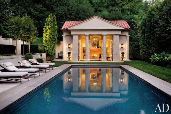 DCA Landscape Architects created the rear garden of designer Thomas Pheasant's Washington, D.C., home. Although Pheasant designed the poolhouse with a classical façade, he used stucco for the walls and Spanish-style tiles for the roof. Photo by Durston Saylor.
