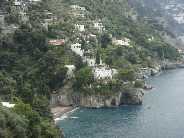 Villa Tre Ville comprises three villas on a promontory overlooking the Terranean sea and the town of Positano. Photo by Cristopher Worthland.