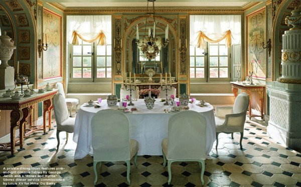 "The pretty and elegantly appointed private dining room features pink-and-gilt console tables by George Jacob and a ""Roses and Myrtle"" Sèvres dinner service commissioned by Louis XV for Mme. du Barry."