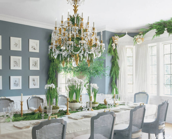 Simply hung fresh green garland lends the cool elegance of this dining room designed by Mary McDonald the feeling of a winter garden.