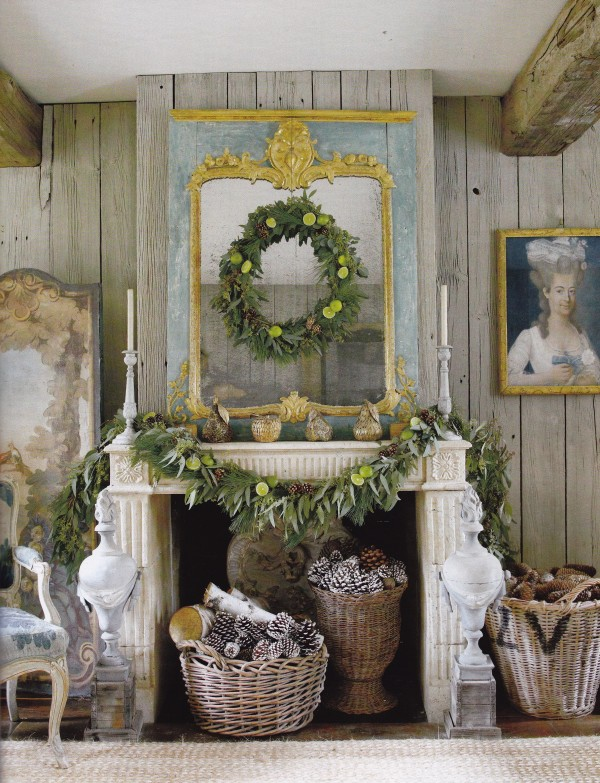 In the same home a wreath and garland made of pine and eucalyptus scents the house, and French, Dutch and Belgian baskets hold pine cones. Photo by Max Kim Bee.