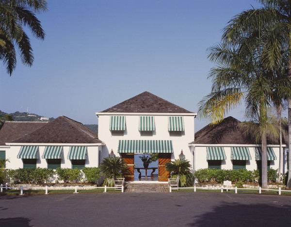 Crisp green-and-white awning stripes greet guests at Roundhill Hotel and Villas on Jamaica.