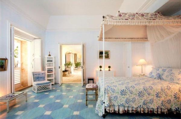A bedroom in Bunny Mellon's  Caribbean retreat featured floors stenciled in a large-scale pattern of blue and green. Photo from Christies.