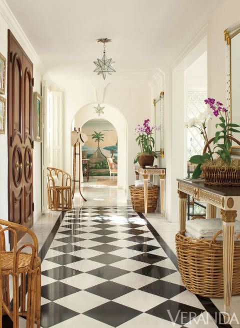 The entrance gallery in a Lyford Cay villa, once owned by Laura Ashley, designed by Andrew Raquet. From Veranda.