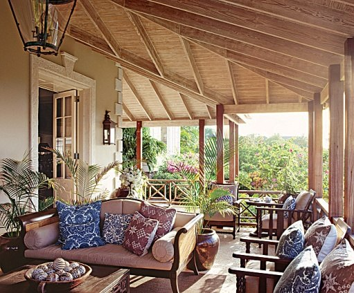 Grant White designed the veranda as an outdoor room for relaxation, dining and cocktails. Photo by Tim Beddow for Architectural Digest.