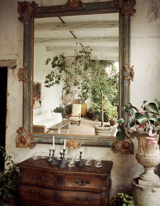 The orangery is reflected in a Louis XIV mirror.
