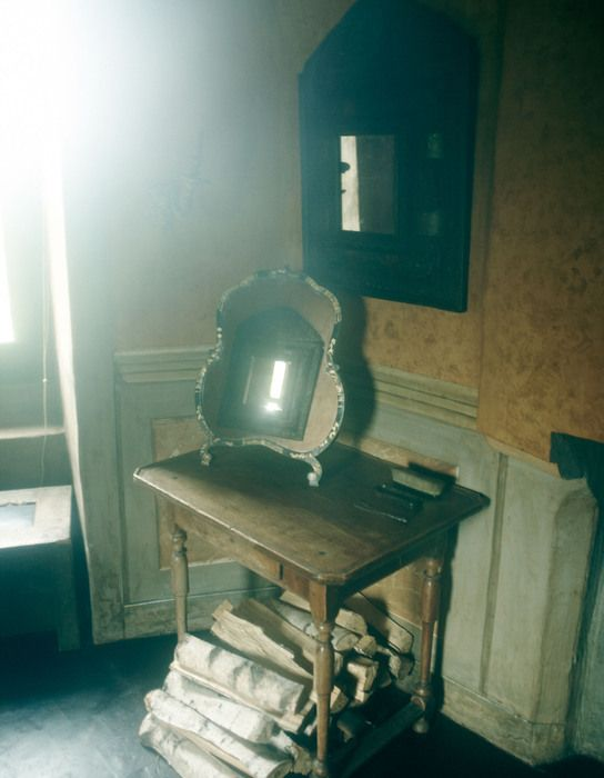An English table and lacquer mirror in one of the castle towers.