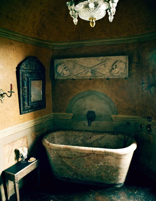 An 18th-century Italian bath, Roman frieze and 1680 French mirror in a bathroom.