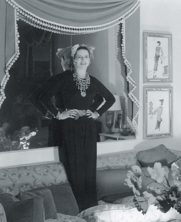 Diana Vreeland posing in her chic George Stacey designed room.