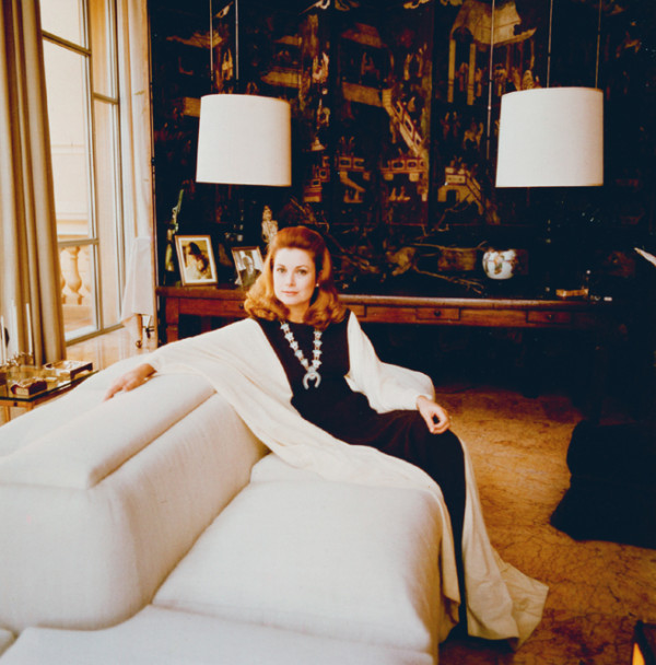 Princess Grace lounges in her conservatory-cum-family room at the Palais Princier in Monaco.